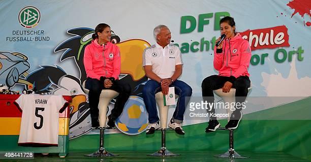 Annike Krahn mdoerator Wolfgang Staab Lisa Weiss of Germany Women's Football Team speak to school children during the visit of the...