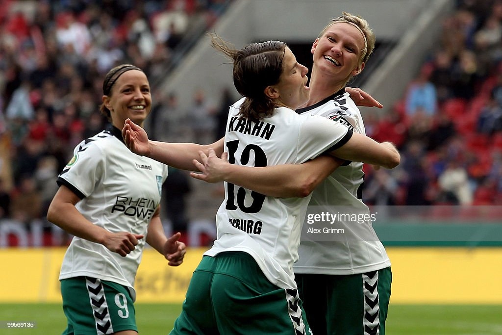Annike Krahn (C) of Duisburg celebrates her team's first goal with team mate Alexandra Popp (R) and Inka Grings (L) during the DFB Women's Cup final match between FCR 2001 Duisburg and FF USV Jena at RheinEnergie stadium on May 15, 2010 in Cologne, Germany.
