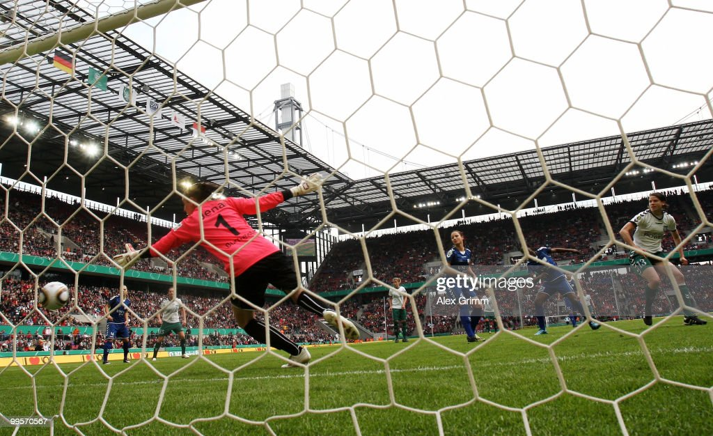 Annike Krahn (R) of Duisburg scores her team's first goal against goalkeeper Jana Burmeister of Jena during the DFB Women's Cup final match between FCR 2001 Duisburg and FF USV Jena at RheinEnergie stadium on May 15, 2010 in Cologne, Germany.
