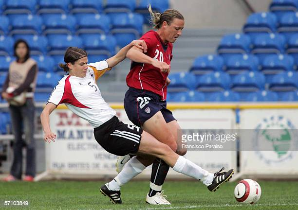 Annike Krahn of Germany and Abby Wanbach of USA vie for the ball during the Womens Algarve Cup match between Germany and USA on March 15, 2006 in...