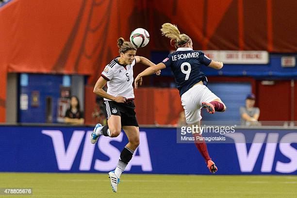 Annike Krahn of Germany and Eugenie Le Sommer of France jump for the ball during the 2015 FIFA Women's World Cup quarter final match at Olympic...