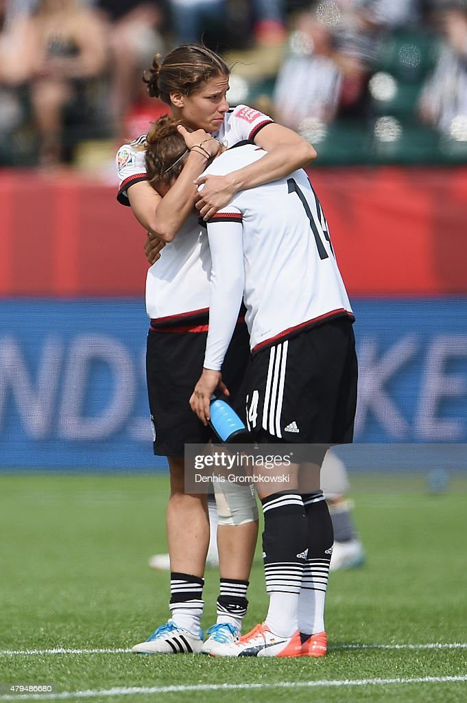 Annike Krahn of Germany hugs team mate Babett Peter after the FIFA Women's World Cup Canada 2015 Third Place Play-off match between Germany and England at Commonwealth Stadium on July 4, 2015 in Edmonton, Canada.