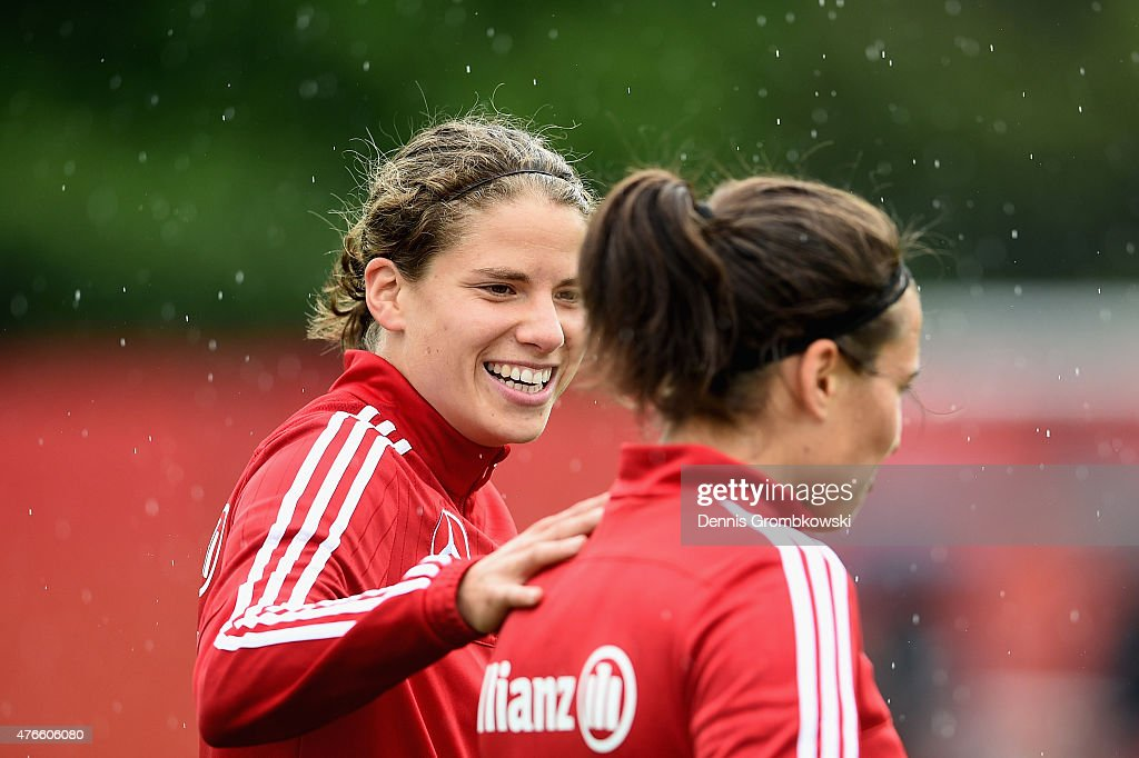 Annike Krahn of Germany reacts towards Dzsenifer Marozsan during a training session at Richcraft Recreation Complex on June 10, 2015 in Ottawa, Canada.