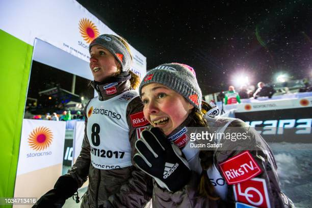 Anniken Mork of Norway and Silje Opseth of Norway watch as teammate Maren Lundby jumps in the Women's Ski Jumping HS100 during the FIS Nordic World...