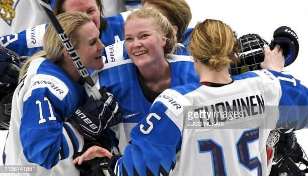 Annina Rajahuhta Noora Räty and Minnamari Tuominen of Finland celebrate their victory after the IIHF Women's Ice Hockey World Championships semifinal...