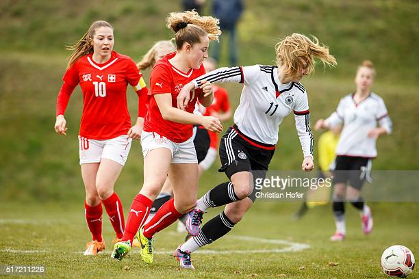 Annina Rauber of Switzerland competes for the ball with Annalena Rieke of Germany during the U17 Girl's Euro Qualifier match between Germany and...