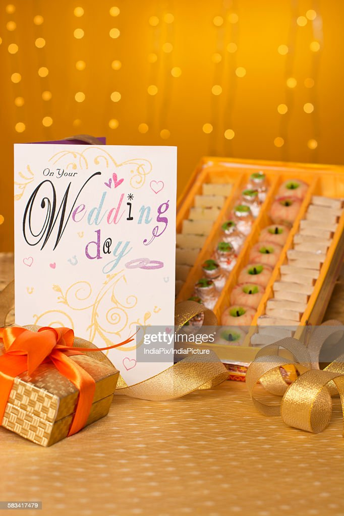Anniversary card with sweets and gift box : Stock Photo