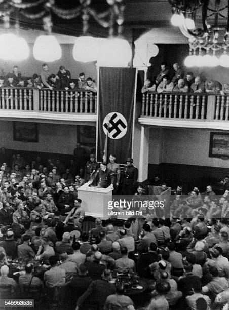 Anniversary of the Beer Hall Putsch metting of comrades at the Buergerbraeukeller Adolf Hitler is delivering a speech behind him Jakob Grimminger...
