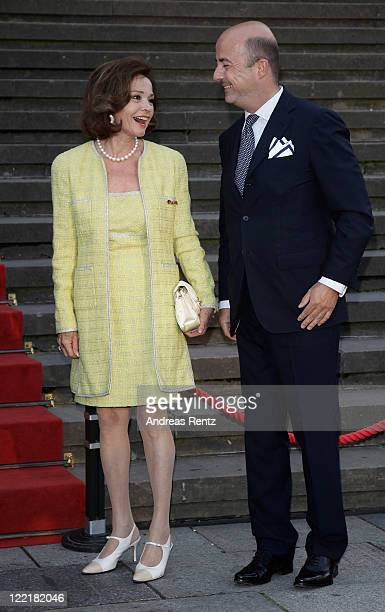 AnnKathrin Bauknecht and guest arrive for a charity concert at the Gendarmenmarkt concert hall on August 26 2011 in Berlin Germany The religious...