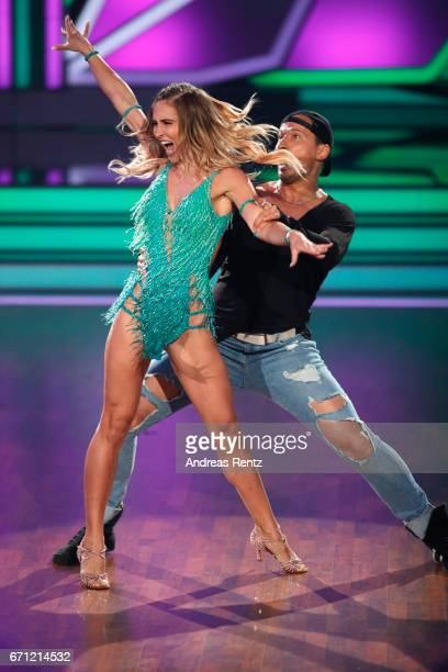 AnnKathrin Broemmel and Sergiu Luca perform on stage during the 5th show of the tenth season of the television competition 'Let's Dance' on April 21...