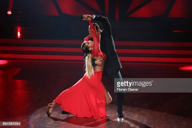 AnnKathrin Broemmel and Sergiu Luca perform on stage during the final show of the tenth season of the television competition 'Let's Dance' on June 9...