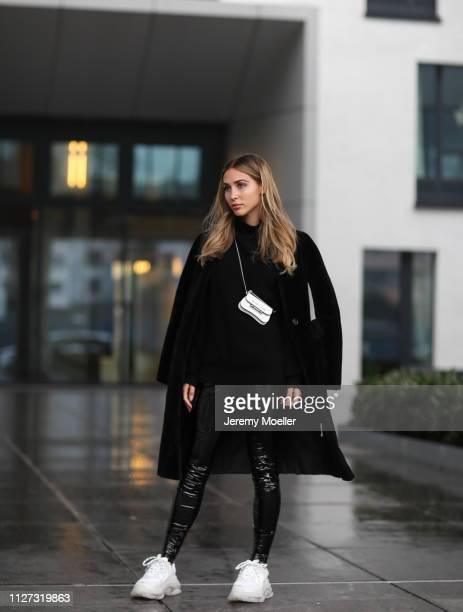 AnnKathrin Goetze wearing Balmain trousers The Row sweater Prada bag Balenciaga Triple S sneaker and a jacket from Zara on February 02 2019 in...
