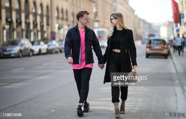 AnnKathrin Goetze wearing Boss coat Dior glasses Louis Vuitton bag Iro pants Zara Crop Sweater gianvito Rossi heels and Mario Goetze wearing OFF...