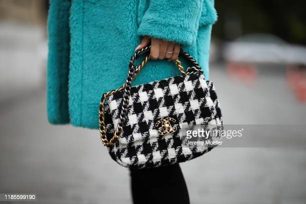 AnnKathrin Goetze wearing Chanel 19 bag Max Mara coat Lovers Friends sweater and L'agence pants on November 04 2019 in Duesseldorf Germany
