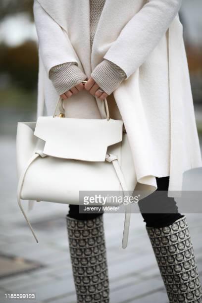 Ann-Kathrin Goetze wearing Harris Wharf London jacket, Ferragamo sweater and boots, Mango pants and Celine bag on November 04, 2019 in Duesseldorf,...