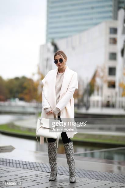 AnnKathrin Goetze wearing Harris Wharf London jacket Ferragamo sweater and boots Mango pants Celine bag and Max Mara sunglasses on November 04 2019...
