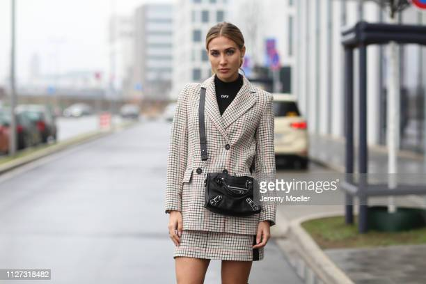AnnKathrin Goetze wearing Maje jacket and skirt Louis Vuitton shoes Balenciaga bag the glasses are from Chanel and Off White sweater on February 02...