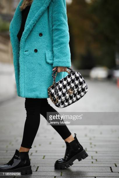 Ann-Kathrin Goetze wearing Prada boots, Chanel 19 bag, Max Mara coat, Lovers & Friends sweater and L'agence pants on November 04, 2019 in...