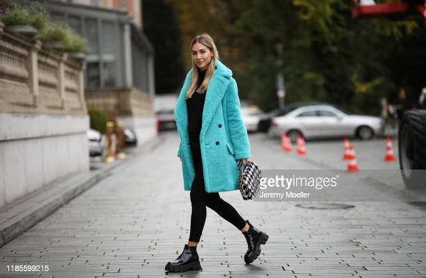 AnnKathrin Goetze wearing Prada boots Chanel 19 bag Max Mara coat Lovers Friends sweater and L'agence pants on November 04 2019 in Duesseldorf Germany