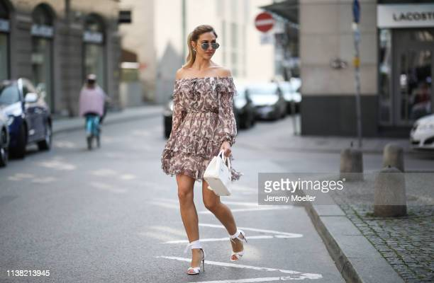AnnKathrin Goetze wearing Zimmermann dress Prada bag and Aquazurra pumps on March 24 2019 in Munich Germany