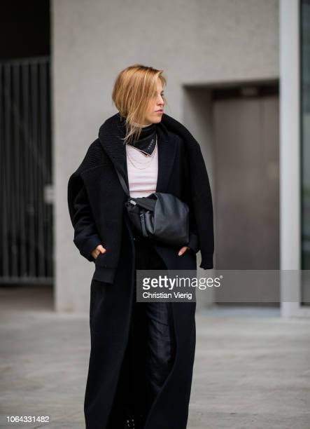 AnnKathrin Grebner wearing Gucci scarf black wool coat black leather boots black pants is seen outside Lala Berlin lunch presenting SS19 collection...