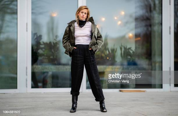 AnnKathrin Grebner wearing olive Lala Berlin jacket Gucci scarf is seen outside Lala Berlin lunch presenting SS19 collection on November 22 2018 in...