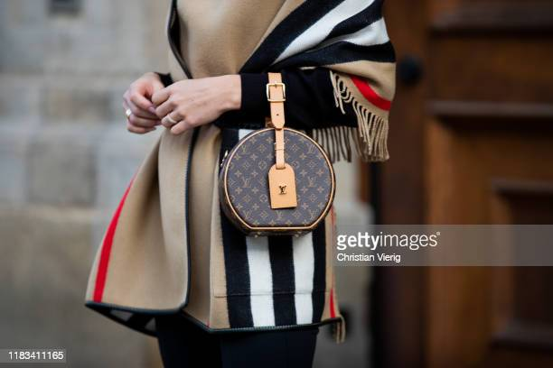 Ann-Kathrin Götze is seen black white red striped Burberry cape, Dior belt, round Louis Vuitton bag, Louis Vuitton shoes on October 25, 2019 in...