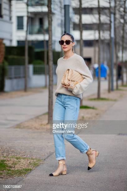 Ann-Kathrin Götze is seen wearing beige Ferragamo jumper, denim jeans Saint Laurent, Chanel bag and shoes in beige, sunglasses Dior on February 06,...