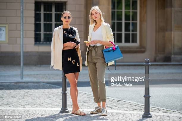AnnKathrin Götze is seen wearing black cropped top with logo print and mini skirt Chanel sandals Chanel sunglasses Olivers x The Row and Mandy Bork...