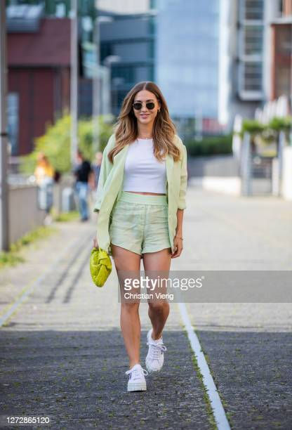 AnnKathrin Götze is seen wearing blazer and shorts Zara Prada sneakers Bottega Veneta bag white cropped tshirt on September 16 2020 in Dusseldorf...