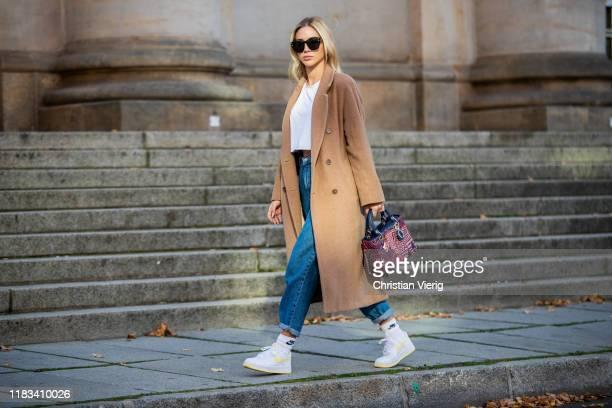 Ann-Kathrin Götze is seen wearing brown coat Aritzia, Celine earrings, Nike sneaker, red Dior bag, Dior sunglasses, white Asos croped tshirt, Mango...