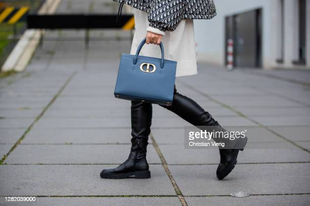 Ann-Kathrin Götze is seen wearing cropped Dior jacket with logo print, Dior St Honoré bag in slate blue, creme white turtleneck knitted dress Mango,...