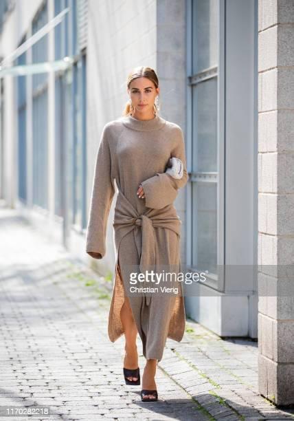 Ann-Kathrin Götze is seen wearing grey beige wrappe dress with slit Nanushka, sandals Bottega Veneta, bag Bottega Veneta, earrings Chan Luu on August...