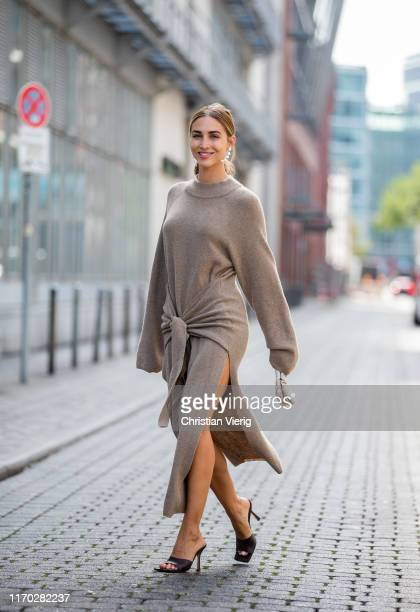 AnnKathrin Götze is seen wearing grey beige wrappe dress with slit Nanushka sandals Bottega Veneta bag Bottega Veneta earrings Chan Luu on August 23...