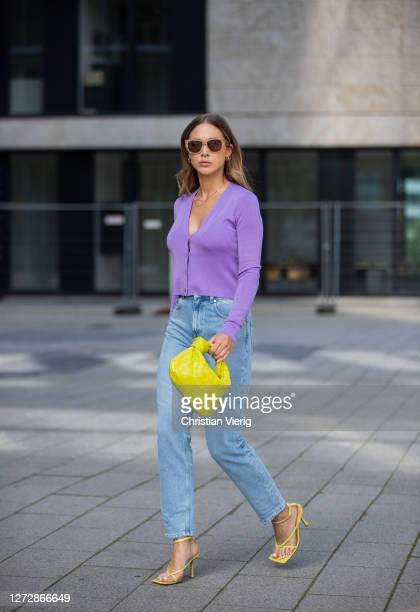 AnnKathrin Götze is seen wearing Nu In jeans purple Prada cardigan heels sunglasses and bag Bottega Veneta on September 16 2020 in Dusseldorf Germany