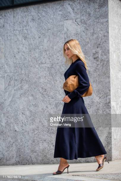 AnnKathrin Götze wearing brown pouch navy dress with long sleeves outside the Sportmax show during Milan Fashion Week Spring/Summer 2020 on September...