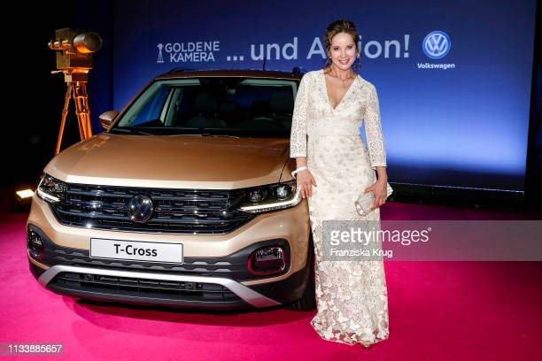 AnnKathrin Kramer poses next to a VW TCross car ahead of the Goldene Kamera awards at Tempelhof Airport on March 30 2019 in Berlin Germany