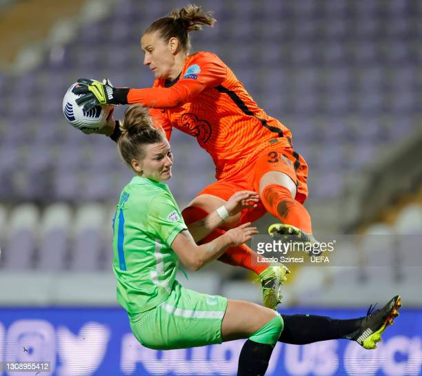 Ann-Katrin Berger of Chelsea is challenged by Alexandra Popp of VfL Wolfsburg during the First Leg of the UEFA Women's Champions League Quarter Final...
