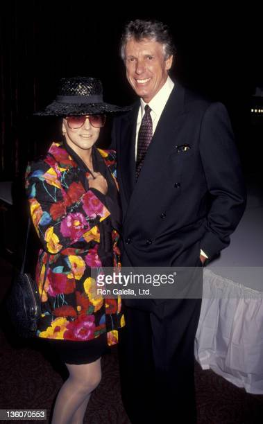 AnnMargaret and Nolan Miller attend Nolan Miller Fall Fashion Show on July 21 1993 at Tatou Club in Beverly Hills California
