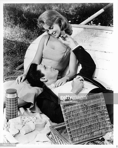 AnnMargret and Elvis Presley enjoying a picnic together in a scene from the film 'Viva Las Vegas' 1964