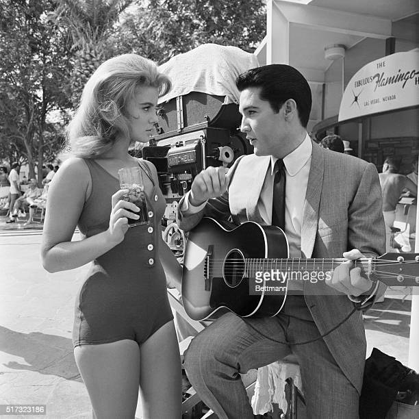 AnnMargret and Elvis Presley rehearse the duet they are to sing in the film Viva Las Vegas