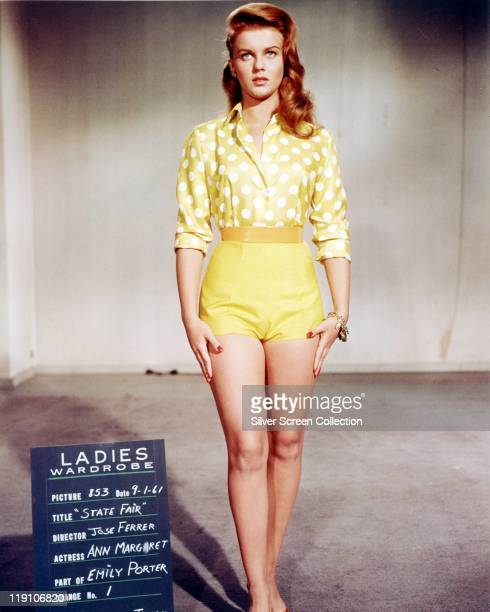 AnnMargret SwedishAmerican actress wearing a yellowandwhite polka dot blouse with yellow shorts and yellow belt in a fulllength wardrobe portrait for...