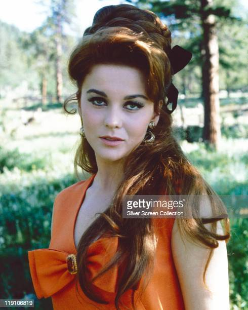 AnnMargret SwedishAmerican actress wearing an orange top with a bow on the chest with her hair draped over her left shoulder circa 1965