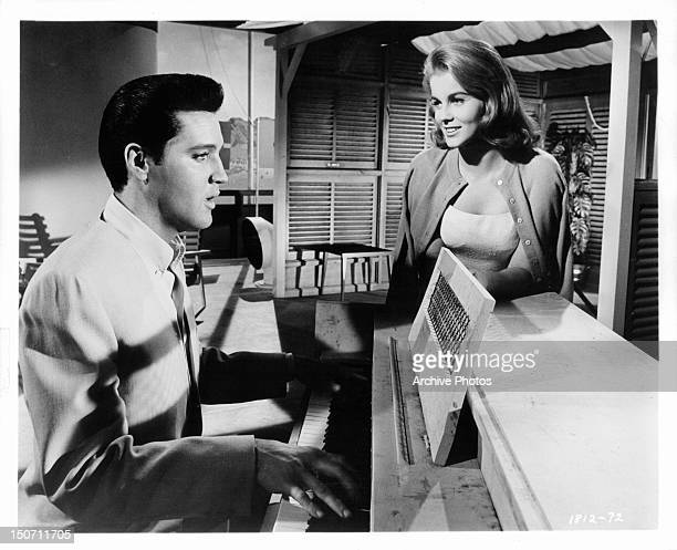 AnnMargret watches Elvis Presley play the piano in a scene from the film 'Viva Las Vegas' 1964