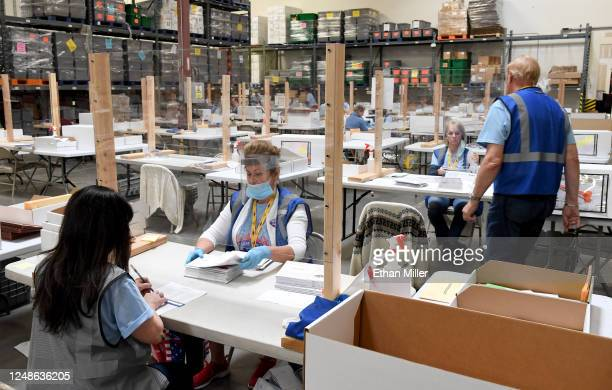 Ann-Marie Gomes and Juanita Thompson count and verify mail ballots at the Clark County Election Department, which is serving as both a primary...