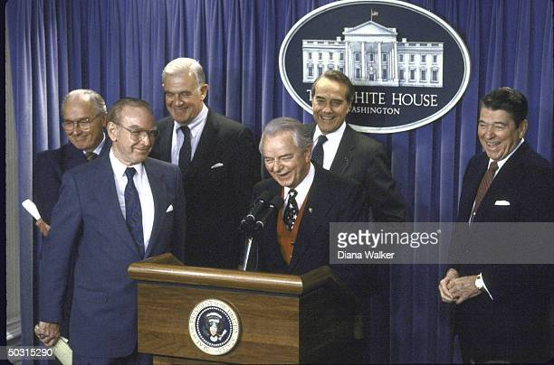 Announcement of the new federal budget including Sen Robert C Byrd at podium with Rep Robert H Michel House Speaker James C Wright Jr Rep Thomas S...