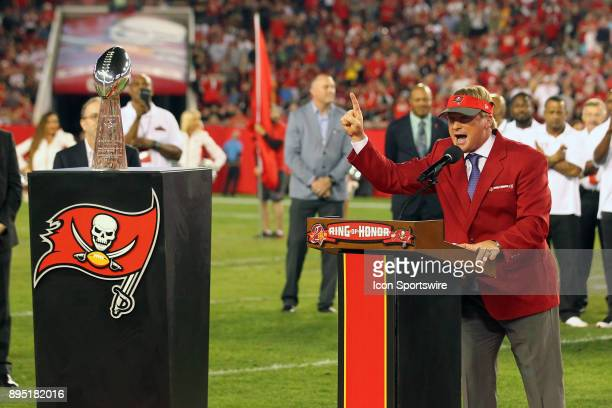 Announcer and former Tampa Bay Buccaneers Super Bowl winning coach Jon Gruden speaks to the fans as he is Inducted into the Buccaneers Ring of Honor...