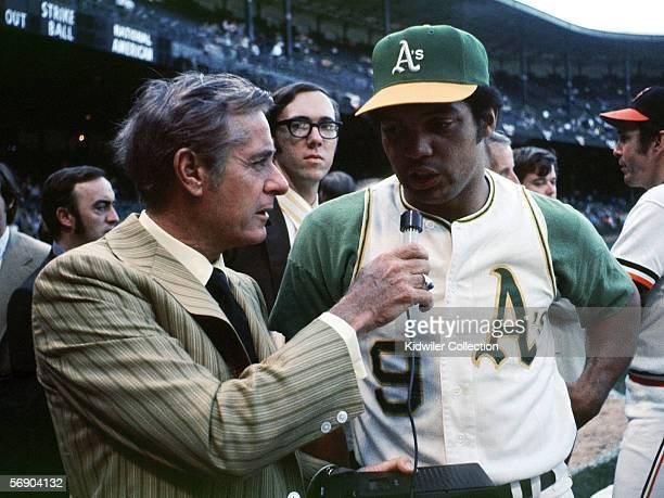 Announcer Curt Gowdy interviews outfielder Reggie Jackson of the Oakland A's prior to the start of the MLB AllStar Game on July 13 1971 at Tiger...