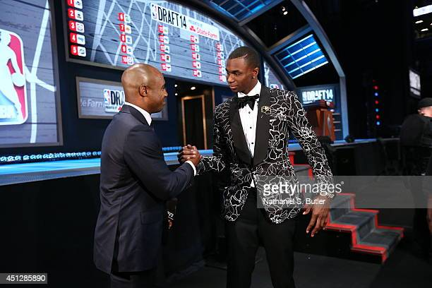 Announcer Jay Williams talks to NBA Draft Prospect Andrew Wiggins before the 2014 NBA Draft at the Barclays Center on June 26 2014 in the Brooklyn...