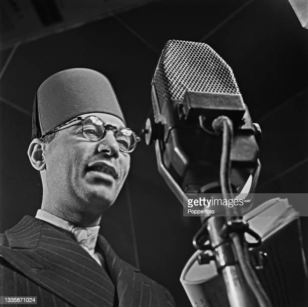 Announcer Shaikh Gomma from the Egyptian section of the BBC Overseas Service delivers a radio news broadcast from a BBC studio in London during World...